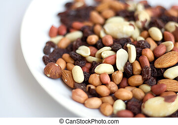 Mixed Nuts on plate - Mixed nuts and rasins on a white plate