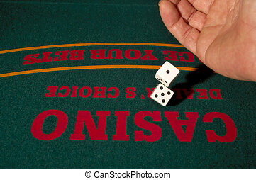 Rolling The Dice - Rolling the dice at a casino craps table