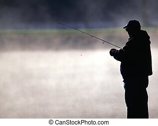 Trout Fisherman - A Trout fisherman prepares his bait for...
