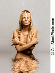 cold shower - picture of wet topless girl standing in water