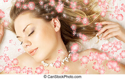 dream with flowers - dreaming beautiful girl surrounded by...