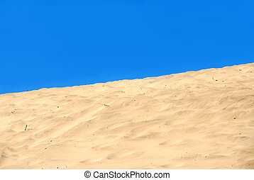 Sand dune - Background of a sand dune with clear blue sky