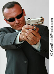 security guard - young men with chromed pistol