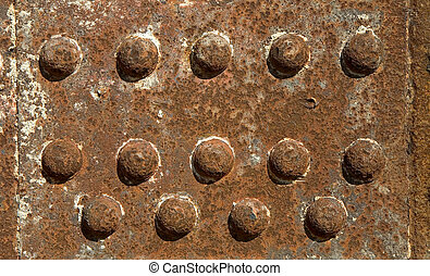 Iron girder with rivets - Close-up of a rusty iron girder...