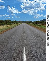 highway road - empty highway between the hills, cloudscape,