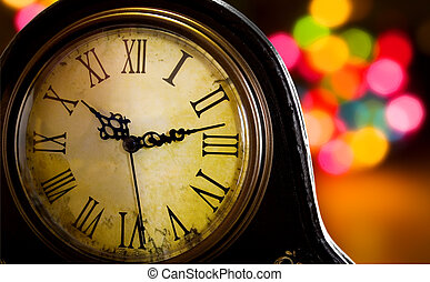 Antique clock - Old clock with christmas lights in the...