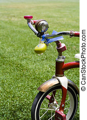 Childs bike - Childs bicycle On Green Lawn