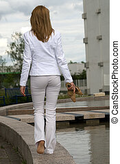 girl walks - young beautiful girl in white dress walks...