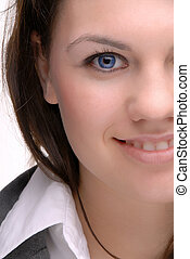 Blue Eyes - Half Face Portrait Of A Pretty Brunette Young...
