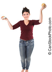 Tipping the scale - Pretty brunette holding up two apples,...