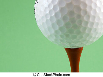 Golf ball on tee - Golf ball sat on a red tee peg