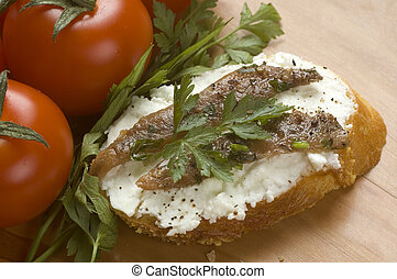 Anchovies - small snack with curd, Anchovies and herbs close...