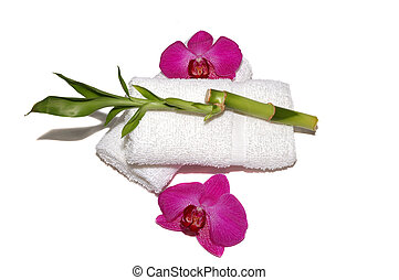 Spa - Orchids, towels, bamboo plant on background