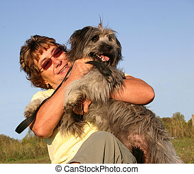 woman and labrit - old woman and her purebreed pyrenes dog