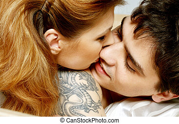 in bed - picture of sweet couple cuddling in bed