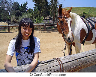 Girl With Horse 2 - Pretty girl standing next to her horse.