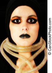 Goth Face - Beautiful young woman in goth make up over black...
