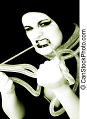Glow - Young woman in goth make-up holding metal cord.