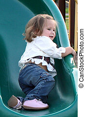 Doin\\\' It My Way - Little girl sliding on a playground...