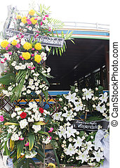 A truck decorated with flowers at the funeral of Phuket\\\'s...