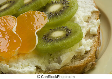 snack with curd, mandarin and kiwi fruit close up