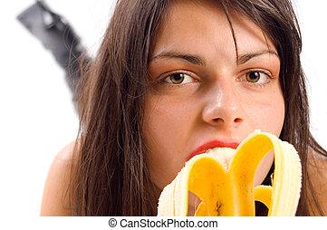 Banana - Young girl eating banana and enyoing with it
