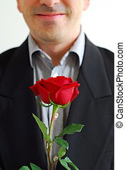 Man red rose - Man in black suit holding a red rose
