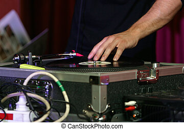 DJ - music turntable - DJ turntable playing. DJ playing the...