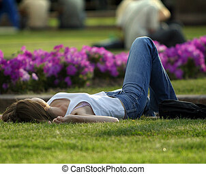 Rest on a lawn - The girl has a rest on a lawn
