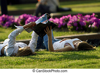 The girls on a lawn - The girl has a rest on a lawn