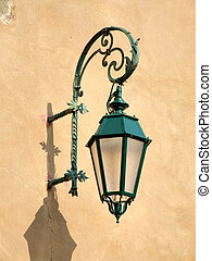 Old decorative streetlamp in Italy - A green street lamp on...