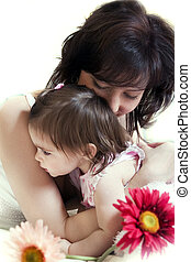 mother\\\'s hugs - happy young mother hugs her little...