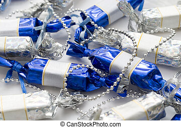 candy garland - garland of blue and white shiny candies on...