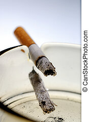 Smoking kills - Picture of half burned cigarette in ash tray...