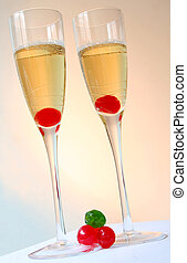 Colourful Champagne Cocktails - Two champagne cocktails with...