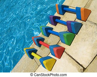 Water aerobics - 1 - Five colorful dumbbell weights for...