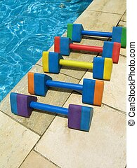 Water aerobics - 2 - Five colorful dumbbell weights for...