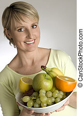 bowl - young blondie holding bowl with fresh fruits
