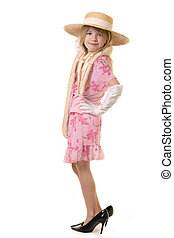 playing dress up - cute little eight year old girl wearing...