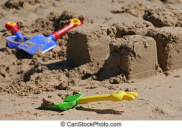 Spades on Beach - Colorful plastic spades in sand on beach