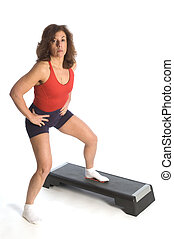 woman exercising on step unit fitness instructor
