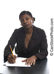 pretty woman at desk - female executive black woman working...