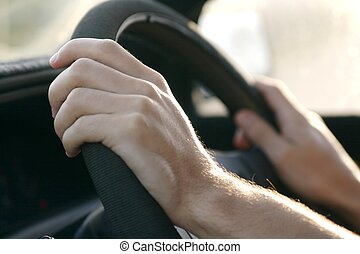 Driving a car - someone driving a car and holding the...