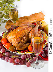 family dinner - Roasted chicken or turkey garnished with...