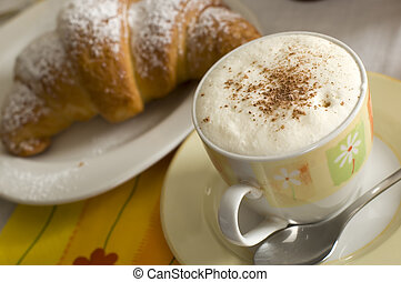 coffee - french Croissant on a plate with coffee in...