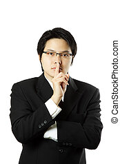 Businessman with his finger on his lips