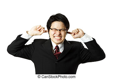 Businessman - A businessman covering his ears with his...