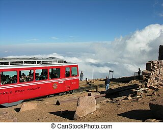 Passenger train arrives to the top of the mountain.