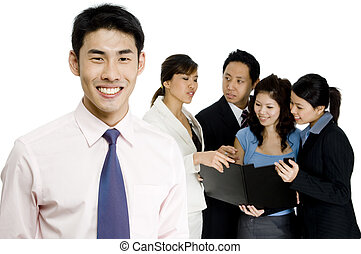 Business Leader - A smiling businessman standing in front of...