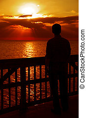 Watching the Sunset, Gulf of Mexico - Person in silhouette...